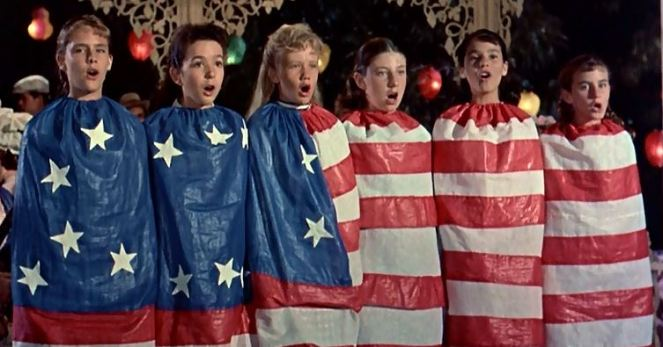"Doesn't this count as flag desecration? And having a British Hayley Mills sing a song about America is like remaking ""Red Dawn"" with Australian Chris Hemsworth in the lead!"