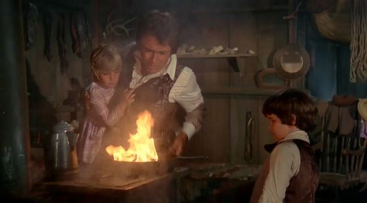 I wonder what child labor laws were like back in the days since the young girl is obviously as close to the fire as she can possibly be.