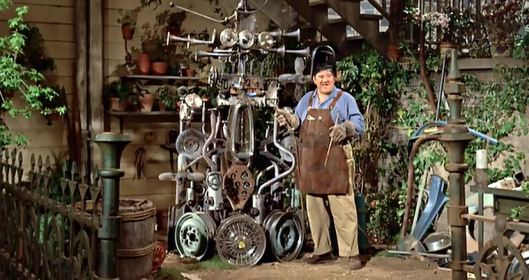 "This opens the door to so many questions: 1) Who names their kid Tennessee? 2) What exactly does Tennessee do for a living? It seems that he just creates random ""pieces of art"" from Jim's crashed cars. But he doesn't sell them or anything. So how does he pay the rent? 3) Buddy Hackett was in a Disney movie before ""The Little Mermaid""?! Etc."